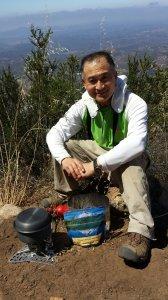 Ren is cooking July 4, 2015 On Iron Mountain Peak.